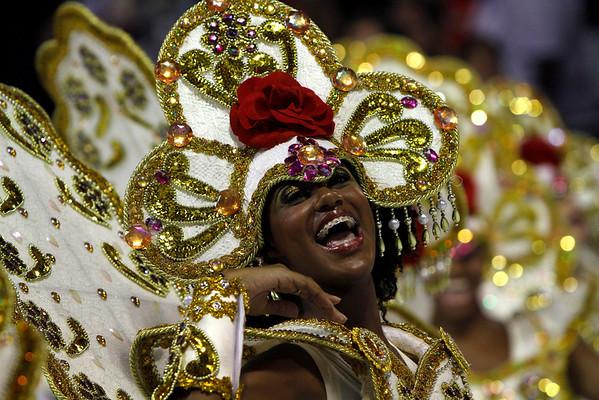 A dancer of the Uniao da Ilha samba school performs during carnival parade at the Sambadrome, in Rio de Janeiro, Sunday, Feb.14, 2010. (AP Photo/Silvia Izquierdo)