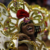 A dancer of the Uniao da Ilha samba school performs during carnival parade at the Sambadrome, in Rio de Janeiro, Sunday, Feb.14, 2010. (AP Photo/Silvia Izquierdo)