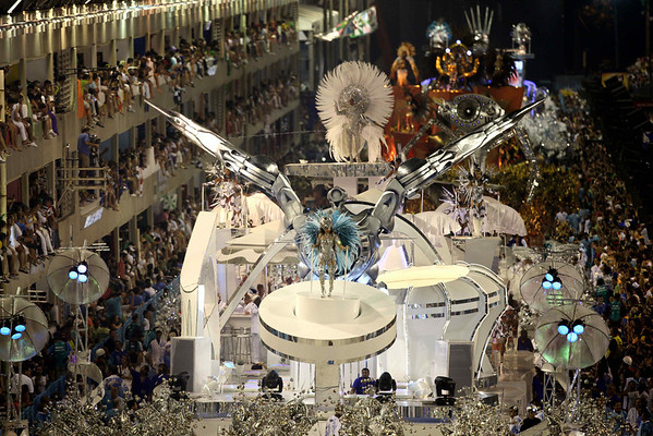 Dancers of Portela samba school perform on a float during carnival celebrations at the Sambadrome in Rio de Janeiro, early Tuesday, Feb. 16, 2010. (AP Photo/Martin Mejia)