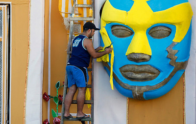 A man works on a carnival parade float from the Viradouro samba school in Rio de Janeiro, Wednesday, Feb. 3, 2010.  Brazil celebrates carnival Feb. 12-16.  (AP Photo/Felipe Dana)