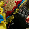 A reveler performs during the traditional carnival of Barranquilla, Colombia, Sunday, Feb. 14, 2010. (AP Photo/ Christian Escobar Mora)