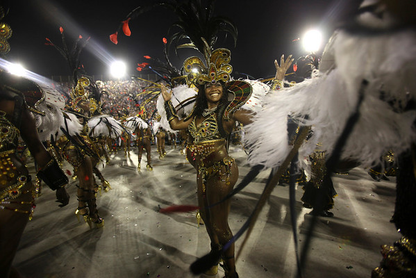 Members of Unidos da Tijuca samba school parade during carnival celebrations at the Sambodrome in Rio de Janeiro, early Monday, Feb. 15, 2010. (AP Photo/Martin Mejia)
