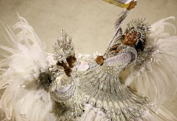 Members of Imperatriz samba school parade during carnival celebrations at the Sambodrome in Rio de Janeiro, Monday, Feb. 15, 2010. (AP Photo/Felipe Dana)