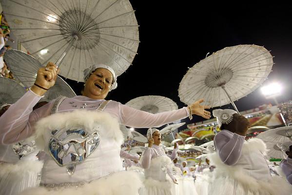 Members of Portela samba school perform during a carnival parade at the Sambadrome in Rio de Janeiro, Tuesday, Feb. 16, 2010. (AP Photo/Felipe Dana)