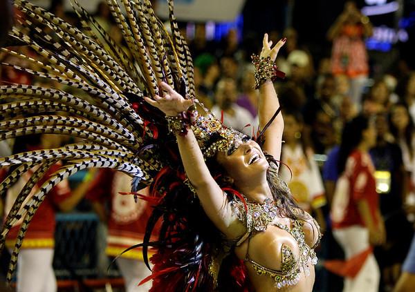 A dancer of Viradouro samba school performs during carnival celebrations at the Sambadrome in Rio de Janeiro, Monday, Feb.15, 2010. (AP Photo/Martin Mejia)