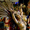 A dancer of Viradouro samba school performs during carnival celebrations at the Sambadrome in Rio de Janeiro, Monday, Feb.15, 2010. (AP Photo/Martin Mejia)