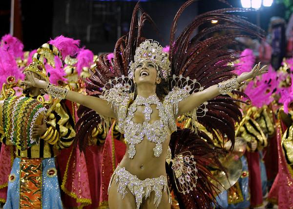 Bruna Bruno, queen of the drums' section of Uniao da Ilha samba school, dances during carnival parade at the Sambadrome, in Rio de Janeiro, Sunday, Feb.14, 2010.  (AP Photo/Martin Mejia)