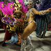 A dancer of Uniao da Ilha samba school performs during carnival parade at the Sambadrome, in Rio de Janeiro, Sunday, Feb.14, 2010. (AP Photo/Martin Mejia)