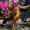 A dancer of Uniao da Ilha samba school performs during carnival parade at the Sambadrome, in Rio de Janeiro, Sunday, Feb.14, 2010. (AP Photo/Martin Mejia)