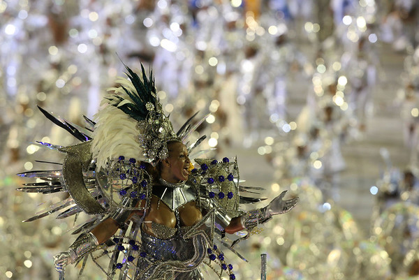 A member of Portela samba school performs during a carnival parade at the Sambadrome in Rio de Janeiro, early Tuesday, Feb. 16, 2010.  (AP Photo/Martin Mejia)