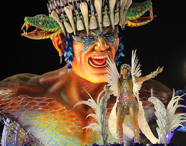 A member of Beija Flor samba school performs on a float during carnival celebrations at the Sambadrome in Rio de Janeiro, early Monday, Feb.15, 2010. (AP Photo/Martin Mejia)