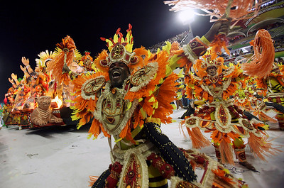 A dancer of the Imperatriz samba school performs during carnival parade at the Sambadrome, in Rio de Janeiro, Monday, Feb.15, 2010. (AP Photo/Martin Mejia)