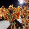 A dancer of the Imperatriz samba school performs during carnival parade at the Sambadrome, in Rio de Janeiro, Monday, Feb.15, 2010. (AP Photo/Martin Mejia)