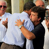 President Barack Obama hugs Grand Isle mayor David Camardelle after he visits Camardelle's, a live bait and boiled seafood restaurant shop, to meet with residents regarding the BP Gulf Coast oil spill in Grand Isle, Louisiana, Friday, June 4, 2010. (AP Photo/Charles Dharapak)