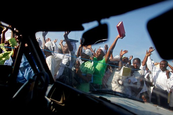 People chant in prayer as they walk the streets of Port-au-Prince in procession, Sunday, Feb. 14, 2010.  One month after a magnitude 7 earthquake struck, Haitians have observed a weekend of mourning and prayer.  (AP Photo/Javier Galeano)