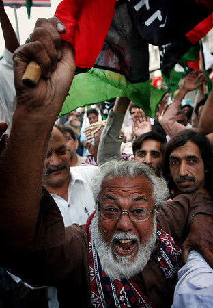 A supporter of Pakistan Peoples Party chants slogans, during a rally to show their support for President Asif Ali Zardari, Sunday, Feb. 14, 2010. Pakistan's prime minister sought to defuse tension Sunday over a Supreme Court decision to strike down a presidential order appointing two top judges, saying the dispute would not threaten political stability. (AP Photo/Fareed Khan)