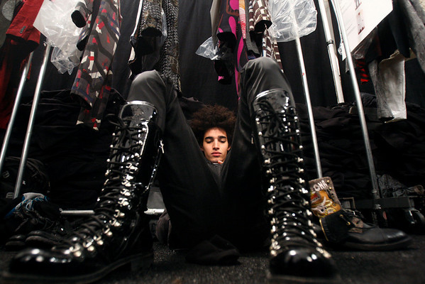 Model Luis Borges relaxes before the Custo Barcelona fall 2010 collection is modeled Sunday, Feb. 14, 2010, during Fashion Week in New York.  (AP Photo/Seth Wenig)
