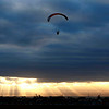 A paraglider hovers above a field at sunrise as an added attraction on the last day of the four-day Philippine Hot Air Balloon festival on Valentine's Day, Sunday, Feb. 14, 2010 at Clark Economic Zone, Angeles city in Pampanga province north of Manila, Philippines. The annual festival attracted 22 hot air balloon participants from different countries as Japan, Germany, Poland, Switzerland and Malaysia. (AP Photo/Bullit Marquez)