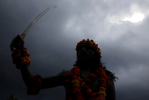 A Hindu holy man holds a sword during a procession as part of monthslong Hindu festival Kumbh Mela, in Haridwar, India, Tuesday, Feb. 9, 2010. The festival, which is celebrated every three years, and rotates among four Indian holy cities is expected to attract more than 10 million people. (AP Photo/ Rajesh Kumar Singh)