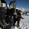 An Afghan army soldier carries a child, Tuesday Feb. 9, 2010, during an evacuation from the avalanche which struck the Salang Pass, Afghanistan. Officials said the avalanches have killed at least 28 people and left another 1,500 stranded in a snow-blocked mountain pass, with the Defense Ministry releasing a statement saying another 70 people have been injured as rescue efforts continued to dig out hundreds of vehicles stuck on the pass north of Kabul.(AP Photo/Altaf Qadri)