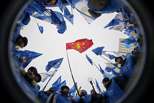 Supporters of Ukrainian opposition leader and presidential candidate Viktor Yanukovych wave flags during a massive rally in front of Central Election Commission, in Kiev, Ukraine,Tuesday, Feb. 9, 2010. (AP Photo/Sergei Grits)