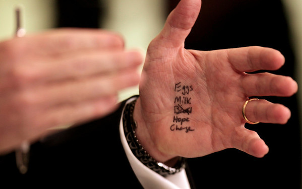 "White House Press Secretary Robert Gibbs has the words ""Eggs, Milk, Bread (crossed out), Hope, and Change"" written in marker on his hand as he briefs reporters after President Barack Obama made an unannounced visit to the James Brady Briefing Room of the White House in Washington, Tuesday, Feb. 9, 2010. Former Vice Presidential candidate Sarah Palin has been seen with hand written notes on her hands in recent public appearances. (AP Photo/Charles Dharapak)"