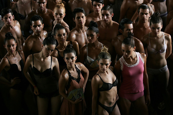 Models pose for pictures at a bus station during National Underwear Day,an event organized by Brazilian fashion website Finissimo in Brasilia, Tuesday, Feb. 9, 2010. (AP Photo/Eraldo Peres)