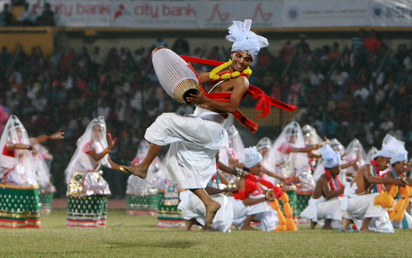 Indian Manipuri dancers perform during the closing ceremony of the 11th South Asian Games in Dhaka,  Bangladesh, Tuesday, Feb. 9, 2010. (AP Photo/ Pavel Rahman)