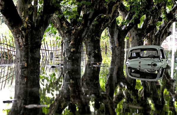 A car sits in a flooded street in Durazno Monday, Feb. 8, 2010. According to local media, more than 4.000 people were evacuated from Durazno after flooding due to heavy rains. (AP Photo/Matilde Campodonico)