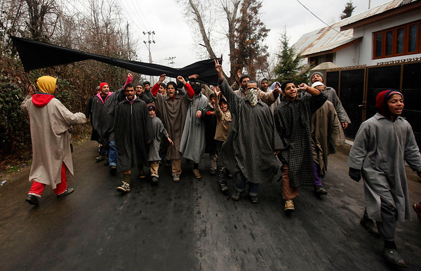 Kashmiri Muslims carry a black banner as they protest the killing of 17-year-old Zahid Farooq Shah, on the outskirts of Srinagar, India, Tuesday, Feb. 9, 2010. Shah who died Friday is the second teenager in last week whose death has been blamed on police and government forces in Indian-controlled Kashmir's main city.Widespread unrest has rocked the disputed Himalayan region for the past week. (AP Photo/ Dar Yasin)