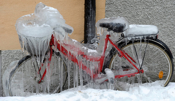 Ice covers a pedal cycle as snow and freezing weather grips the area around Stockholm, Sweden, Tuesday Feb. 9, 2010.  (AP Photo /Leif R Jansson,  SCANPIX)