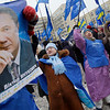 Supporters of Ukrainian opposition leader and presidential candidate Viktor Yanukovych hold his portrait during a rally in front of the Central Election Commission, in Kiev, Ukraine, Tuesday, Feb. 9, 2010.  (AP Photo/Sergei Grits)