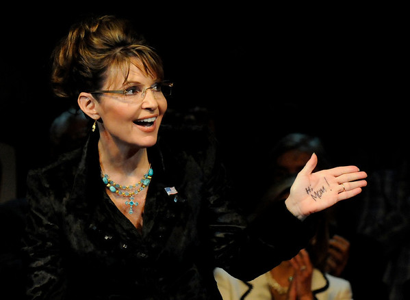 In this Feb. 7, 2010 photo, former Alaska Gov. Sarah Palin sends a message to her mother, written on her left hand, at a campaign rally for Texas Gov. Rick Perry  in Cypress, Texas. (AP Photo/Pat Sullivan)