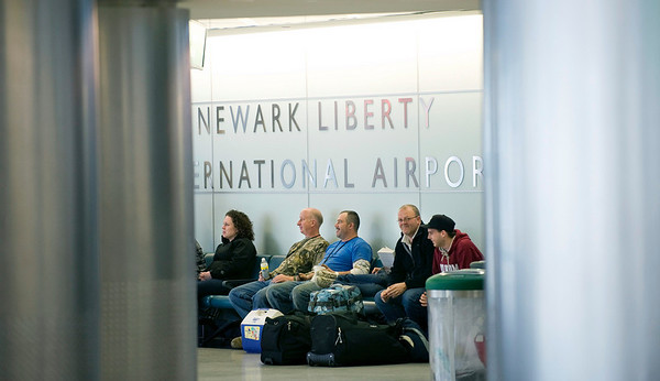Travelers hoping to take flights to parts of Europe found themselves stuck at Terminal B at Newark Liberty International Airport, on Friday, April 16, 2010, in Newark, N.J., as flights were canceled due to the ash cloud from a volcano in Iceland. (AP Photo/Joe Epstein)