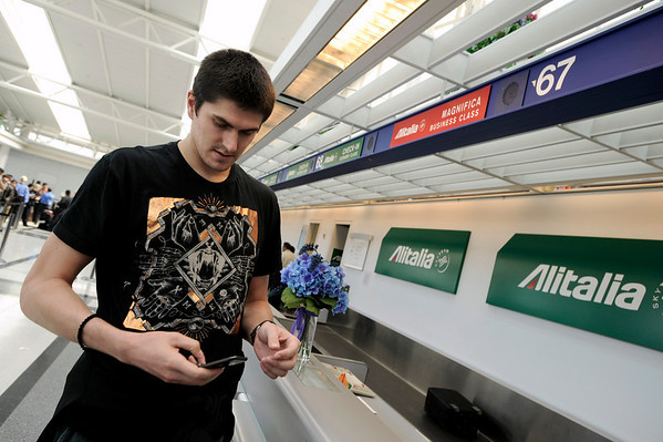Minnesota Timberwolves basketball player Darko Milicic  makes a phoone call at the Alitalia Airlines ticket counter at O'Hare International Airport in Chicago, after finding out that all the flights going to his home country of Serbia were canceled on Friday, April 16, 2010. The air traffic agency Eurocontrol said almost two-thirds of Europe's flights were canceled Friday because of a volcanic ash cloud moving in from Iceland.  (AP Photo/Paul Beaty)