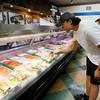 Mike Diorio buys fish at the Fish King Seafood market Friday April 16, 2010 in Glendale, Calif. Deliveries of fish from overseas may be affected due to delayed supply flights from the ash cloud from a volcano in Iceland. (AP Photo/Nick Ut)