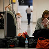 A woman reads in a a closed check in area at the Benito Juarez International airport in Mexico City, Friday, April 16, 2010.  Commercial flights to northern Europe were canceled due to a drifting plume of volcanic ash originating from a volcanic eruption in Iceland. (AP Photo/Eduardo Verdugo)