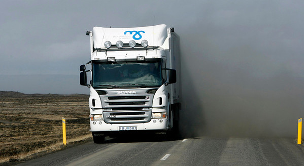 A passing truck whips up a cloud of fallen volcanic ash Friday April 16 2010, some 120km east of the capital Reykjavik, Iceland. The Eyjafjallajokull  glacier volcano began erupting for the second time in a month on Wednesday, sending ash several miles (kilometers) into the air. Authorities told people in the area with respiratory problems to stay indoors, and advised everyone to wear masks and protective goggles outside. (AP Photo/Brynjar Gauti )