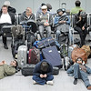 Travelers wait at the closed international Airport in Duesseldorf, Germany, Friday, April 16, 2010. Most countries in northern Europe suspended their air traffic due to ash clouds from the volcanic eruption in Iceland. (AP Photo/Martin Meissner)
