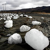 Ice chunks carried downstream by floodwaters caused by volcanic activity lie on the Markarfljot river bank Friday April 16 2010, some 120km east of the capital Rejkavik, Iceland. The Eyjafjallajokull  glacier volcano began erupting for the second time in a month on Wednesday, sending ash several miles (kilometers) into the air. Winds pushed the plume south and east across Britain, Ireland, Scandinavia and into the heart of Europe causing travel chaos. (AP Photo/Brynjar Gauti )
