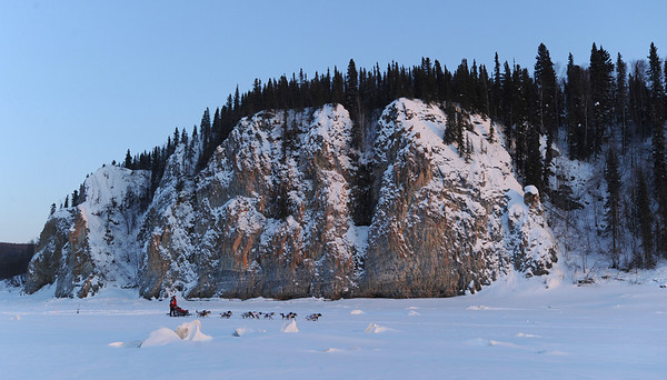 Aliy Zirkle passes in front of the cliffs just outside of the Yukon River checkpoint of Ruby, Alaska  checkpoint on Friday, March 12, 2010 during the Iditarod Trail Sled Dog Race. (AP Photo/Anchorage Daily News, Bob Hallinen)