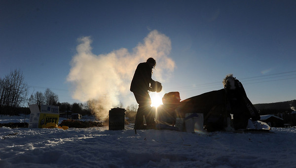 Kristy Berington feeds her dog team at the Ruby, Alaska checkpoint on Saturday morning March 13, 2010 on during the Iditarod Trail Sled Dog Race. (AP Photo/Anchorage Daily News, Bob Hallinen)