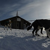 Sonny Lindner of Two Rivers, Alaska,  leaves the  Ruby, Alaska checkpoint past the Ruby Bible Church on Friday, March 12, 2010 during the Iditarod Trail Sled Dog Race. (AP Photo/Anchorage Daily News, Bob Hallinen)