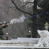 A riot policeman opens fire on demonstrators with teargas in Bishkek, Kyrgyzstan, Wednesday, April 7, 2010. Police in Kyrgyzstan opened fire on thousands of angry protesters who tried to seize the main government building amid rioting in the capital as protests spread across the Central Asian nation. (AP Photo/Ivan Sekretarev)