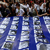 Members of human rights groups Grandmothers of the Plaza de Mayo and Mothers of the Plaza de Mayo, carrying a banner with images of people missing during the 1976-83 dictatorship, march during a demonstration marking the 34th anniversary of the 1976 military coup in Buenos Aires, Wednesday March 24, 2010. (AP Photo/ Natacha Pisarenko)