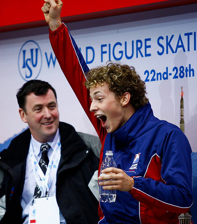 Adam Rippon, right,  from the United States reacts as the marks are posted for his short program as his coach Brian Orser looks on during the men's competition  at the World Figure Skating Championships in Turin, Italy, Wednesday, March 24, 2010. (AP Photo/The Canadian Press, Paul Chiasson)