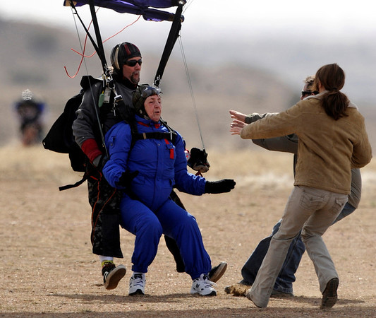 In this Monday, March 22, 2010 photo, 80-year-old Catherine Smith touches down strapped to the front of instructor Mike Neslin at the end of a tandem skydive at Skydive The Rockies at the Fremont County Airport near Canon City, Colo. Smith jumped from a plane to celebrate her birthday and to raise money for the Colorado Springs Senior Center. (AP Photo/The Colorado Springs Gazette, Mark Reis) MAGS OUT; NO SALES