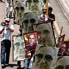 People carry posters with the image of Archbishop Oscar Arnulfo  Romero while participating in a rally to commemorate the 30th anniversary of Monsignor Oscar Arnulfo Romero's death , San Salvador Wednesday  March 24, 2010. Archbishop Romero was shot to death in 1980 by a sniper as he celebrated Mass in San Salvador after he had urged the Salvadoran military to halt death squads that had killed thousands of suspected guerrillas and leftist opponents of the government.(AP Photo/Luis Romero)