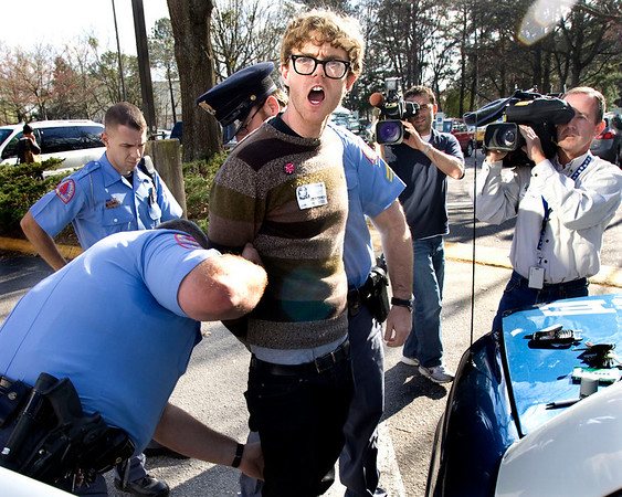 A protester, Dante Strobino, is arrested outside the Wake County school board meeting as the board ends Wake County's long-standing diversity policy Tuesday, March 23, 2010.  (AP Photo/The News & Observer, Corey Lowenstein)