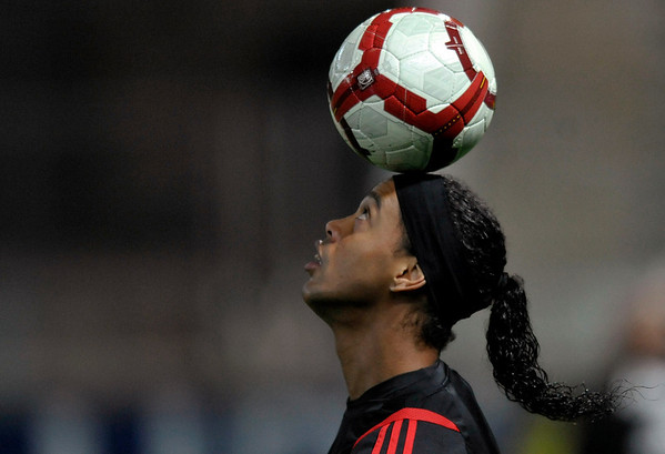 AC Milan forward Ronaldinho, of Brazil, balances the ball prior to the start of the Italian Serie A soccer match between Parma and AC Milan at Tardini stadium in Parma, Italy, Wednesday, March 24, 2010. (AP Photo/Marco Vasini)